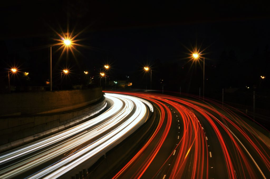Photo of busy highway at night